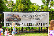 Historic Nunley's Carousel Centennial Celebration on Saturday, June 9, 2012, at Museum Row, Garden City, Long Island, New York, USA. 100th Anniversary festivities included old time game of croquet; a visit from ex-President Theodore Roosevelt - portrayed by actor James Foote - who ran again for President in 1912 (unsuccessfully, as Bull Moose Party candidate), the year Nunley's Carousel debuted; and Carousel rides.
