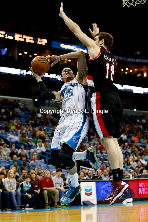Feb 13, 2013; New Orleans, LA, USA; New Orleans Hornets shooting guard Austin Rivers (25) shoots over Portland Trail Blazers small forward Victor Claver (18) during the second quarter of a game at the New Orleans Arena. Mandatory Credit: Derick E. Hingle-USA TODAY Sports