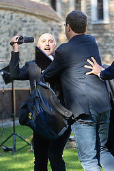A protester is ushered away after accusing Bellingcat investigators of working for NATO at a press conference on College Green opposite the Houses of Parliament. London, October 09 2018.