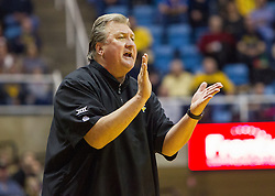 Dec 23, 2016; Morgantown, WV, USA; West Virginia Mountaineers head coach Bob Huggins claps from the bench during the first half against the Northern Kentucky Norse at WVU Coliseum. Mandatory Credit: Ben Queen-USA TODAY Sports