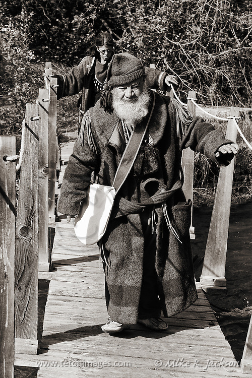 Sepia photographs of a mountain men crossing a foot bridge at a rendezvous held at Camp Henry, ID. Trappers and traders assemble  at the historic camp site each June.