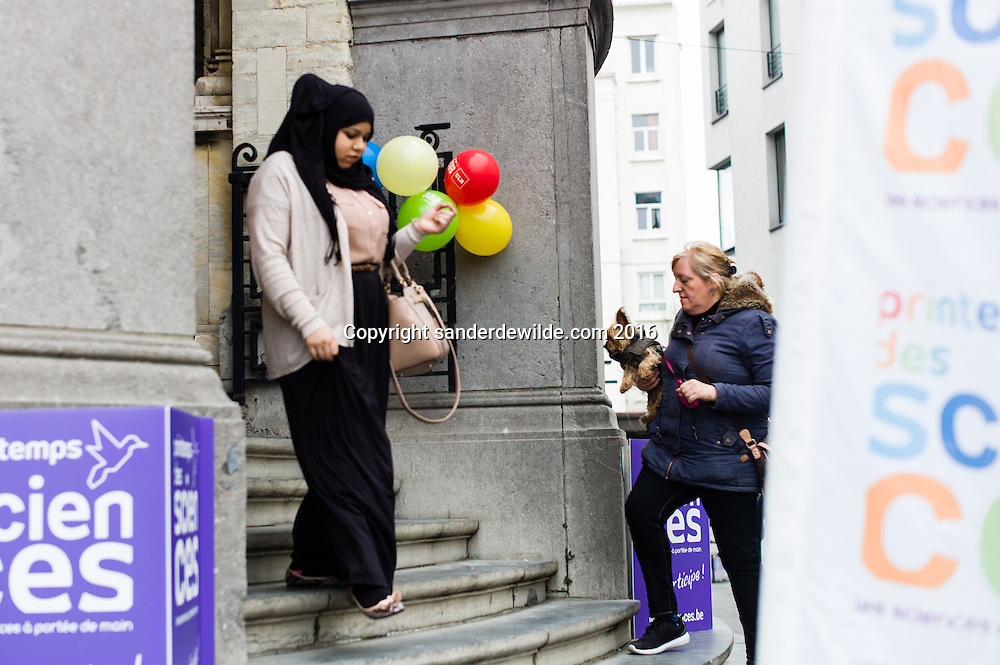 20160319 story on the streets and people of Molenbeek, after Salam Abdeslam was arrested a day before.  People going in and out of the Molenbeek townhall