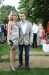 NICK CANDY and HOLLY VALANCE at the annual Serpentine Gallery Summer party this year sponsored by Jaguar held at the Serpentine Gallery, Kensington Gardens, London on 8th July 2010.  2010 marks the 40th anniversary of the Serpentine Gallery and the 10th Pavilion.