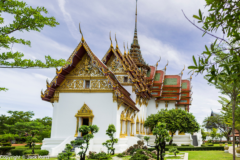 16 JULY 2014 - SAMUT PRAKAN, SAMUT PRAKAN, THAILAND: A replica of the Dusit Maha Prasat Palace (Grand Palace) in Bangkok, built in 1806, at Ancient Siam. Ancient Siam is a historic park about 200 acres (81 hectares) in size in the city of Samut Prakan, province of Samut Prakan, about 90 minutes from Bangkok. It features historic recreations of important Thai landmarks and is shaped roughly like the country of Thailand.      PHOTO BY JACK KURTZ