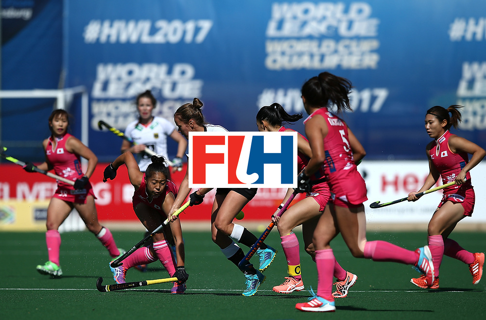 JOHANNESBURG, SOUTH AFRICA - JULY 16:  Jana Teschke of Germany battles with Yu Asai of Japan during day 5 of the FIH Hockey World League Women's Semi Finals Pool A match between Japan and Germany at Wits University on July 16, 2017 in Johannesburg, South Africa.  (Photo by Jan Kruger/Getty Images for FIH)