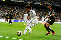 Real Madrid´s Marcelo Vieira and Malaga´s Samuel Garcia Sanchez during 2014-15 La Liga match between Real Madrid and Malaga at Santiago Bernabeu stadium in Madrid, Spain. April 18, 2015. (ALTERPHOTOS/Luis Fernandez)
