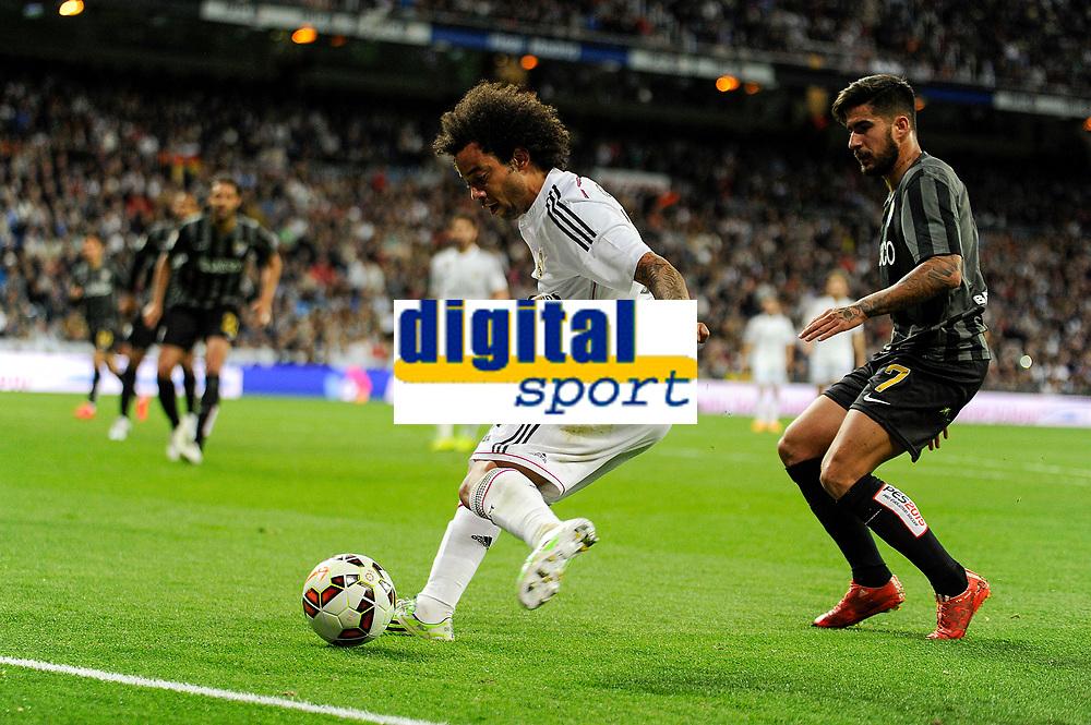 Real Madrid´s Marcelo Vieira and Malaga´s Samuel Garcia Sanchez during 2014-15 La Liga match between Real Madrid and Malaga at Santiago Bernabeu stadium in Madrid, Spain. April 18, 2015. (ALTERPHOTOS/Luis Fernandez)