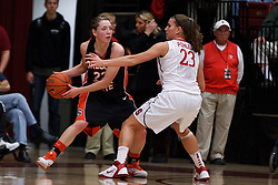 February 24, 2011; Stanford, CA, USA;  Oregon State Beavers guard Sage Indendi (22) is defended by Stanford Cardinal guard Jeanette Pohlen (23) during the first half at Maples Pavilion.  Stanford defeated Oregon State 73-37.