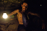 Portrait of coal miner biker in mine shaft during shift - Colombia