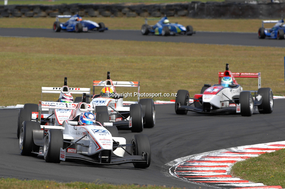 Andrew Tang from Singapore in his Toyota FT40 in second place at the start of the Grand Prix.