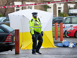 © Licensed to London News Pictures. 06/02/2019. London, UK. A police evidence tent covers a crime scene in Westbridge Road in Battersea after a 19 year old man was fatally stabbed last night. Police have arrested two men. Photo credit: Peter Macdiarmid/LNP