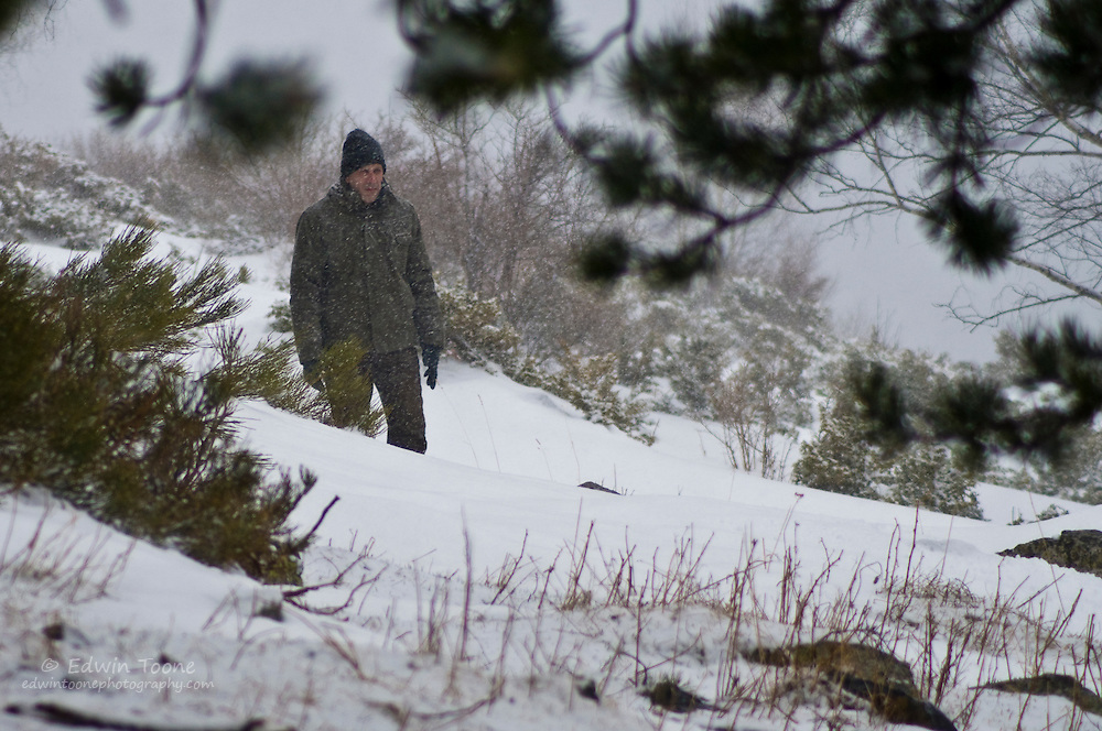 The man in the ice, played by Jordi Cortes, appears in a snow storm.