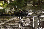 A g-scale train, moves along a tresle as it passes through the garden.  It's part of Jack and Sharon Wilson's 'Little River Railroad' during the open garden tour for garden railroad clubs from Cincinnati, Columbus and Indianapolis, Sunday, July 15, 2007.