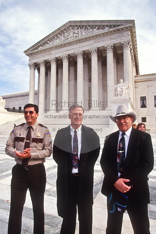 Plaintiffs Sheriff Richard Mack (L), Jay Printz  with attorney David Hardy (c) outside the Supreme Court in Washington Tuesday, Dec. 3, 1996, after a hearing to discuss the Brady gun-control law.