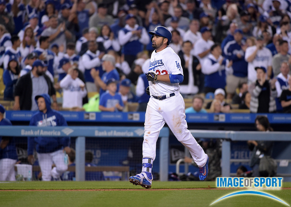 Apr 13, 2016; Los Angeles, CA, USA; Los Angeles Dodgers first baseman Adrian Gonzalez (23) rounds the bases after hitting a solo home run in the fourth inning against the Arizona Diamondbacks during a MLB game at Dodger Stadium.