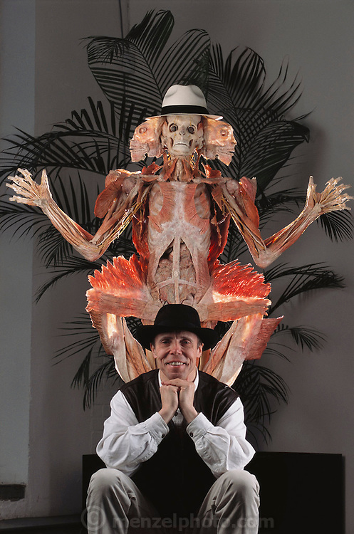 "Gunther von Hagens seen with the ""Winged Man"" from his Body Worlds exhibit. Body Worlds is a traveling exhibit of real, plastinated human bodies and body parts. Von Hagens invented plastination as a way to preserve body tissue and is the creator of the Body Worlds exhibits.  [2002]."