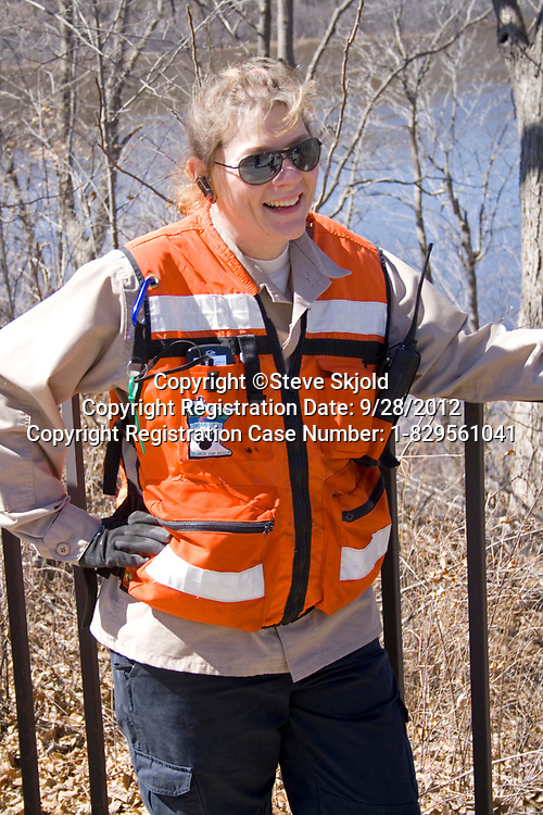 Search and Rescue Emergency Support Services woman taking a break from finding lost college student. St Paul Minnesota MN USA