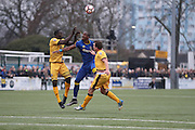 Sutton United Kevin Amankwaah (2), AFC Wimbledon striker Tom Elliott (9) and Sutton United Captain Jamie Collins (6) battle for possession during prior The FA Cup match between Sutton United and AFC Wimbledon at Gander Green Lane, Sutton, United Kingdom on 7 January 2017. Photo by Stuart Butcher.