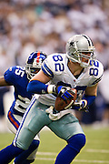 IRVING, TX - JANUARY 13:   Jason Witten #82 of the Dallas Cowboys runs with the ball after making a catch against the New York Giants during the NFC Divisional playoff at Texas Stadium on January 13, 2008 in Dallas, Texas.  The Giants defeated the Cowboys 21-17.  (Photo by Wesley Hitt/Getty Images) *** Local Caption *** Jason Witten