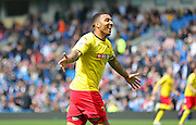 Watford Troy Deeney celebrates the winning goal during the Sky Bet Championship match between Brighton and Hove Albion and Watford at the American Express Community Stadium, Brighton and Hove, England on 25 April 2015. Photo by Phil Duncan.