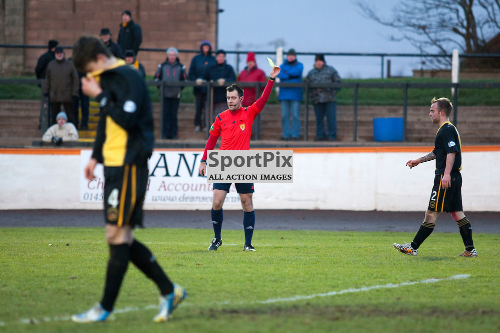 Devon Jacobs (Berwick 2) is shown a yellow card by referee Don Robertson, who awarded Elgin a penalty for the challenge in the Berwick Rangers v Elgin City league match at Shielfield Park, Berwick. 31 January 2014<br /><br />(c) Russell G Sneddon / SportPix.org.uk