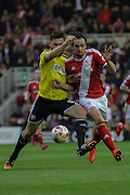 Kike beats Harlee Dean to the ball during the Sky Bet Championship Play Off Second Leg match between Middlesbrough and Brentford at the Riverside Stadium, Middlesbrough, England on 15 May 2015. Photo by Simon Davies.