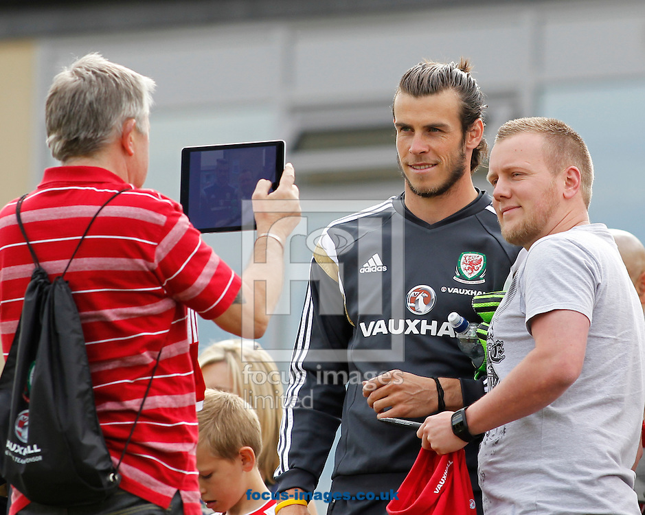 Gareth Bale poses with fan before the Wales Training session at the Vale Resort, Hensol<br /> Picture by Mike Griffiths/Focus Images Ltd +44 7766 223933<br /> 08/06/2015