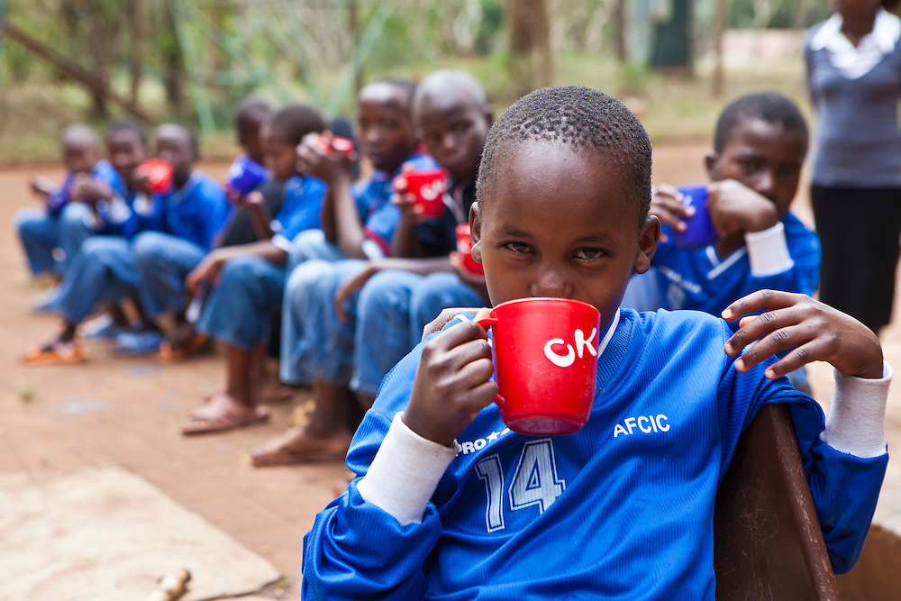 The children enjoy hot drink at the AFCIC centre in Thika, Kenya. AFCIC - Action for children in conflict, help children who have been affected by various forms conflict or crisis.