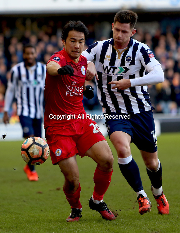 February 18th 2017, The Den, Millwall, London England; FA Cup 5th Round football, Millwall versus Leicester City; Leicester City forward Shinji Okazaki tackled by Millwall defender Calum Butcher