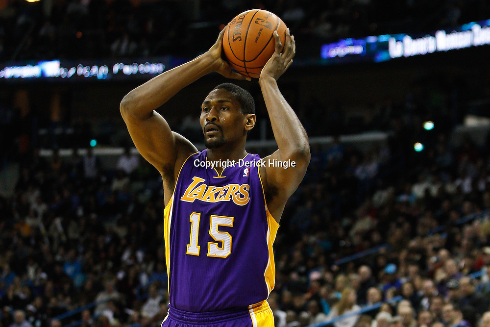 February 5, 2011; New Orleans, LA, USA; Los Angeles Lakers small forward Ron Artest (15) against the New Orleans Hornets during the first quarter at the New Orleans Arena.   Mandatory Credit: Derick E. Hingle