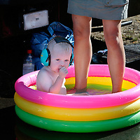 Germany, Hockenheim, 23-08-2003.<br /> Auto racing.<br /> Dragster race.<br /> A child of a driver has ear protection on if he plays in his pool.<br /> Photo: Klaas Jan van der Weij.