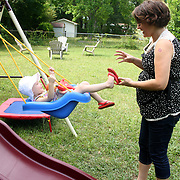Holly Larue Frizzelle plays with her mother Leilani Frizzelle in their backyard in Wilmington, N.C. On December 27, 2012 two year old Holly Larue Frizzelle was diagnosed with Acute Lymphoblastic Leukemia. What began as a stomach ache and visit to her regular pediatrician led to a hospital admission, transport to the University of North Carolina Children's Hospital, and more than two years of treatment.
