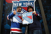 May 13, 2015 - New York, NY. Yoshi and Junko Shigeta showcase their Ranger Fandom prior to game 7 against the Washington Capitals. Photograph by Anthony Kane/NYCity Photo Wire