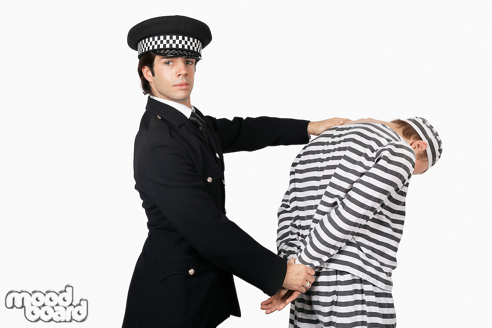 Portrait of confident police officer with male prisoner against white background