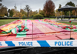© Licensed to London News Pictures. 04/11/2018. Woking, UK. A deflated slide remains cordoned off in Woking Park after it collapsed injuring eight children. The park was holding a fireworks party when the accident happened. Photo credit: Peter Macdiarmid/LNP