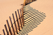 Sand fence and shadow on a sand dune in Corolla North Carolina.