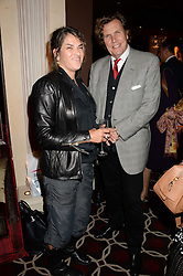 TRACEY EMIN and THEO FENNELL at a party to celebrate the publication of 'Passion for Life' by Joan Collins held at No41 The Westbury Hotel, Mayfair, London on21st October 2013.