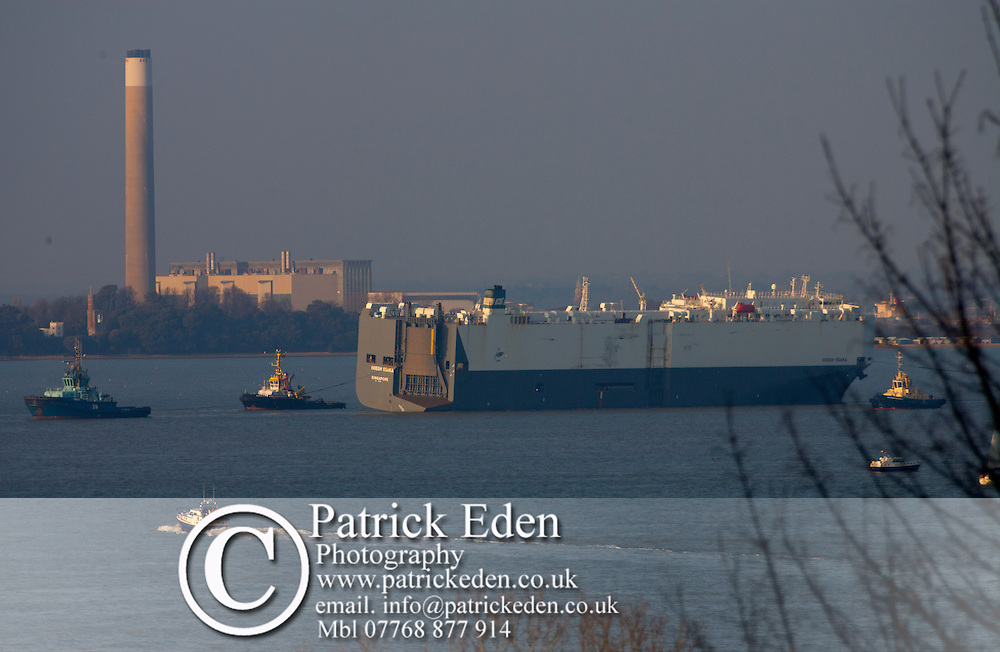 Hoegh Osaka The Solent England being towed into Southampton Hampshure UK after being refloated after being beached onto The Brambles Sandbank in the middle of The Soelnt. 22/01/2015 Cowes, Isle of Wight, England,