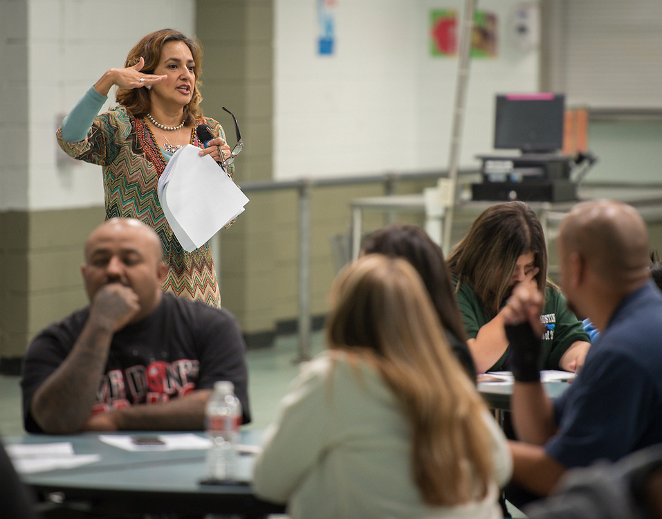 Assistant principal Ivonne Rodriguez comments during an English language PowerUp parents meeting at Austin High School, November 7, 2013.