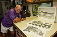 Roger Gagne of the Lakes Region Art Association shows his graphic drawings of the 10th tee at the Laconia Country Club from his home studio on Thursday morning. Top drawing is from 1920, middle drawing 1960 and bottom drawing as it is today.    (Karen Bobotas/for the Laconia Daily Sun)