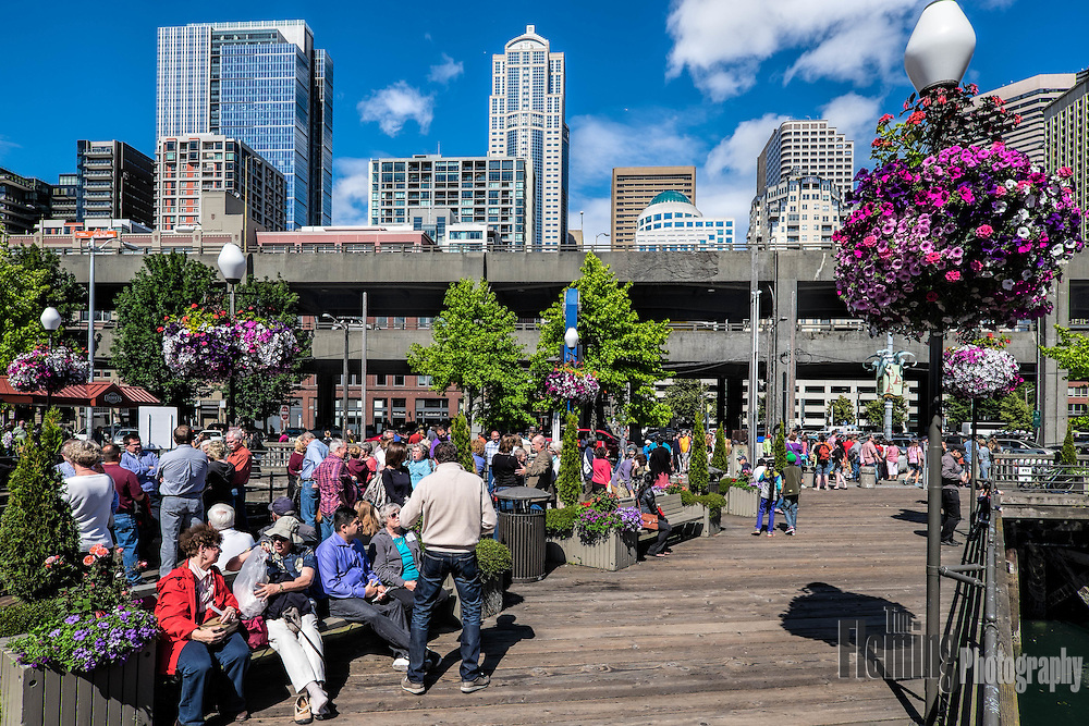 The waterfront in downtown Seattle, looks out towards Puget Sound. Visitors can take in the view or visit the many attractions.