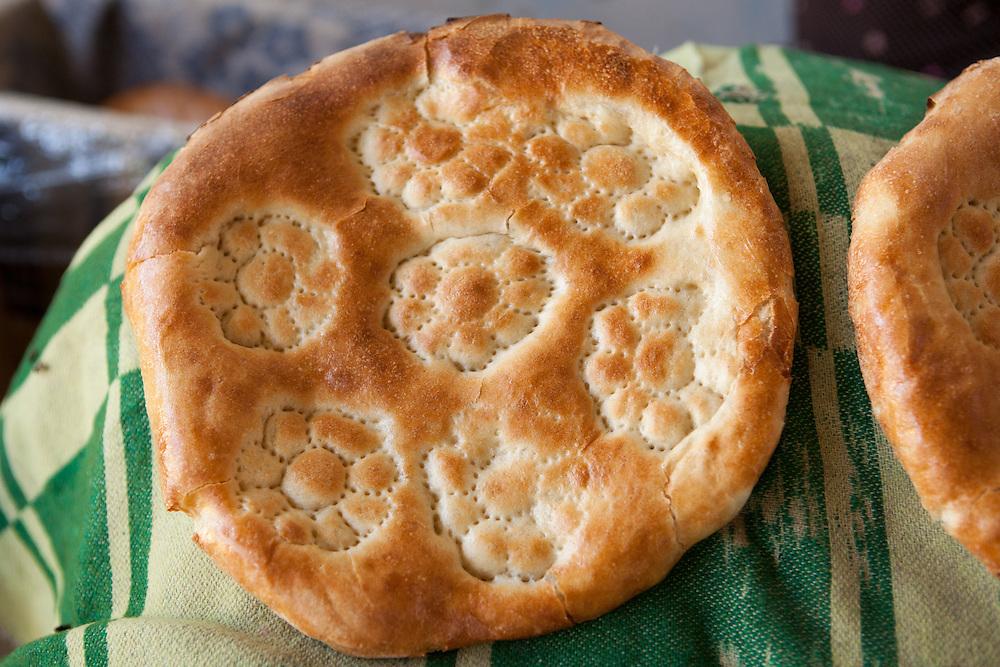 Local Turkmen flat bread (çörek) made in a stone oven, here sold in a market