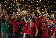 Spain's footballers celebrate with the trophy after winning the 2010 World Cup South Africa football after defeating by 1-0 to Netherlands in the final match, at Soccer City stadium, in Johannesburgo, South Africa, on July 11, 2010.   (Alejandro Pagni/PHOTOXPHOTO).