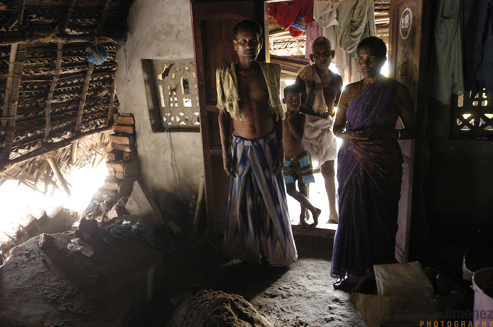 Fisherman Govindan, left, with his wife Lakshmi, stand in their damaged home, which sits just yards from the ocean, in the fishing village of Perumalpettai in Tamil Nadu, India on January 21, 2005, after the area was struck by the Indian Ocean Tsunami on December 26, 2004, killing 37 of the villagers and destroying nearly all of their fishing boats. Generated by an earthquake on the ocean floor, the tsunami devastated the fishing industry along the southeastern coast of India.