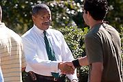 18356The Freshman Convocation 9/03/2007...Dr. McDavis greets freshman at the Alumni Gateway