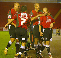 Photo: Aidan Ellis.<br /> Darlington v Swansea City. The FA Cup. 02/12/2006.<br /> Swansea's Andy Robinson is congratulated after scoring the second
