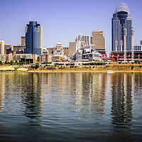 Photo of Cincinnati skyline over the Ohio River with most popular downtown city buildings including Great American Ballpark, Great American Insurance Group Tower, PNC Tower building, Omnicare building, US Bank building, Carew Tower building, and Scripps Center building. Photo was taken in July 2012 and is high resolution.