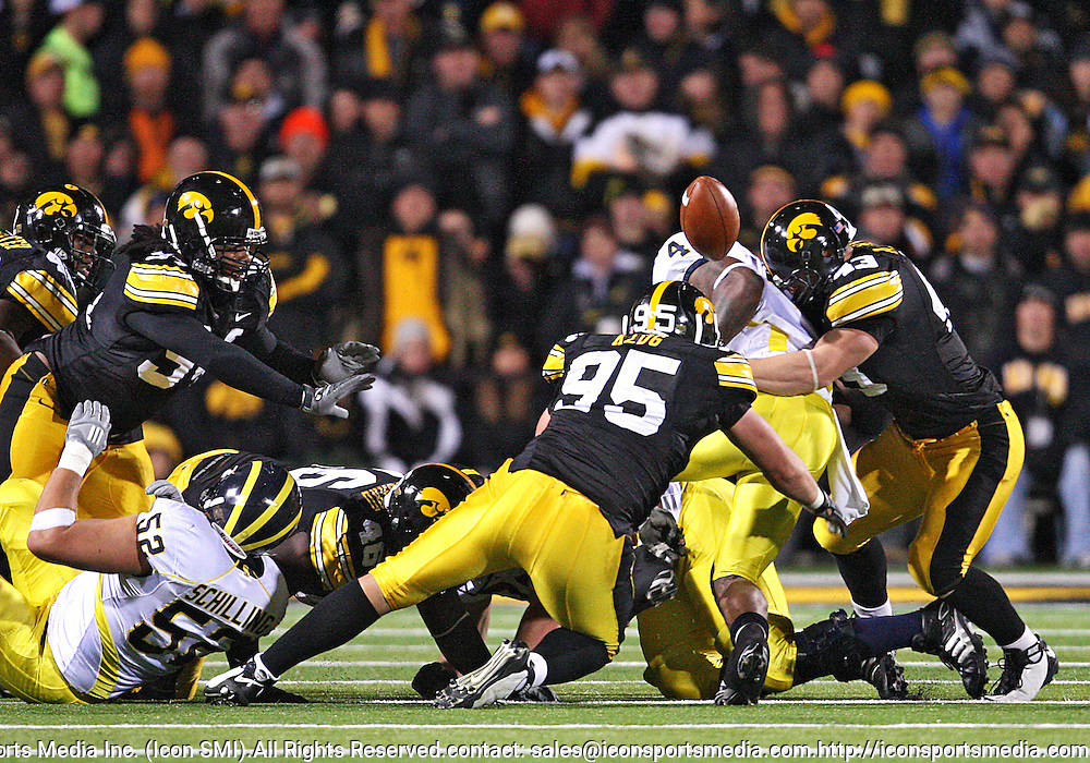 October 10, 2009: Michigan running back Brandon Minor (4) fumbles the ball during the first half of the Iowa Hawkeyes' 30-28 win over the Michigan Wolverine's at Kinnick Stadium in Iowa City, Iowa on October 10, 2009.