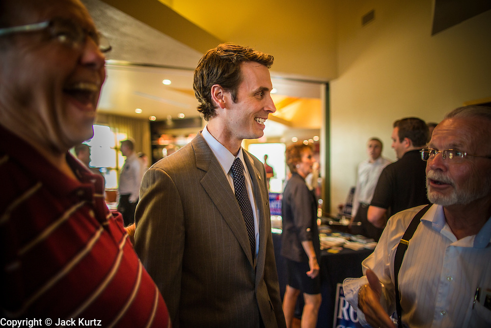 02 JULY 2012 - PARADISE VALLEY, AZ:    Congressman BEN QUAYLE, son of former Vice President Dan Quayle, talks to supporters at a Republican candidate forum in Paradise Valley Monday. David Schweikert and Quayle, both conservative freshmen Republican Congressmen from neighboring districts are facing each other in an August primary to see which one will represent Arizona's 6th Congressional District in 2013. The two were thrown into the same district as a result of legislative redistricting.   PHOTO BY JACK KURTZ