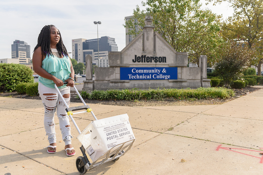 Katrice Gill, 28, a communications major/ social justice minor at Jefferson Community and Technical College, walks to deliver campus mail to the Jefferson Education Center building on Broadway under a Federal Work Study Program. (Photo by Brian Bohannon)